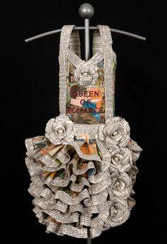 My Fair Ladies, Queen of Romance, 2009, Vintage Romance Comics and Romance Novels, Costume Jewelry, Text, Glitter, Gel Medium, Acrylic Spray, Steel Base. 63 X 12 X 12 inches.