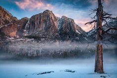 Yosemite valley with morning fog and snow - This is a photograph of foggy morning at Yosemite with colorful clouds.
