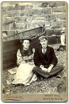 Victorian photograph of an unknown couple sitting on the beach by Pearson, West Hill, Hastings, East Sussex.