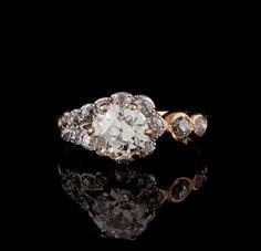 Yellow Gold Diamond Ring features an Old Mine cut diamond