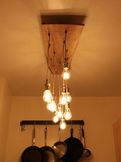 Reclaimed Live Edge Wood Chandelier with Victorian Edison bulbs. $945.00, via Etsy.