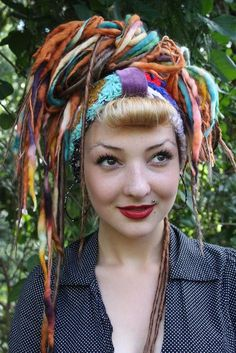 "I'm not sure I could ever pull this ""hair"" off but MAN would I love to try.  All it is is yarn, felt and ribbon but it's got so much personality I can hardly stand it."