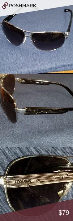 a348cc7806a Guess Aviator Sunglasses Asshole Pair of Guess Aviator Sunglasses for men  or women with attitudes.