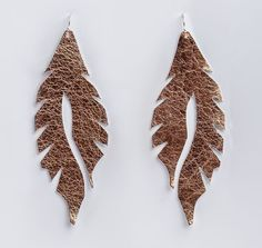 Holiday gifts under $15: Handmade leather feather earrings from Edge of Urge