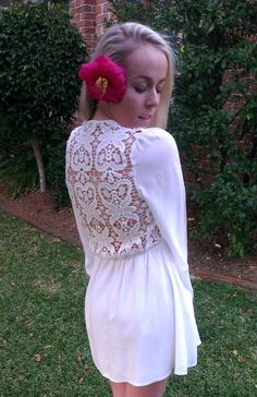 Stunning back feature! Beautiful white dress. Perfect for the beach.
