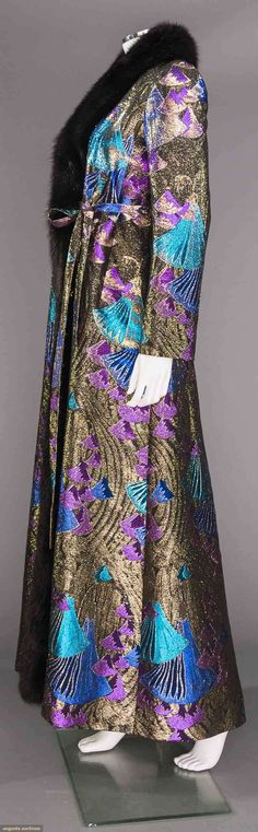 """DIOR COUTURE EVENING COAT & CROQUIS, 1971 October 25, 2017 New York City Purple, gold & turquoise lame in abstract fan shapes, black fox fur collar & edging, inner waist tie, black silk lining, side pockets, script tape beneath label w/ fabric content, includes croquis & photo of model in coat, label """"Christian Dior Automne-Hiver 1971 Paris"""", L 57"""", (some fabric pulls) excellent."""