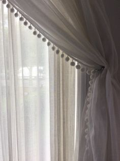 Muslin curtain with Pom Pom edge
