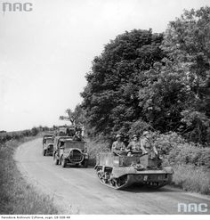 Transport column of infantry 1st Armoured Division. Visible: Universal Carrier armored personnel carrier and trucks with soldiers.