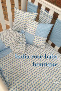 Teeny tiny baby elephants and soft blue polka dot baby bedding