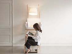 "Seoul-based designer Yang Si Young created the ""Library Chair"" in answer to a personal challenge: to design a piece of furniture that's also a library; with built-in shelving and …"