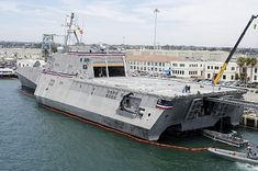 The Littoral Combat Ship USS Independance (LCS 2) recovers a boat while moored at Naval Base San Diego