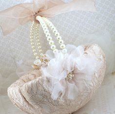 Flower Girl Basket Bridal Basket in Champagne and Ivory with Pearls and Lace Vintage Inspired. $125.00, via Etsy.