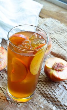 Peach Iced Tea Recipe - This sun tea is infused with fresh ripe peaches and honey. A refreshing and natural summertime beverage! #drink #tea wonkywonderful.com