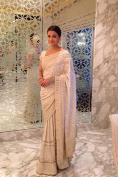 Beautiful white sari worn by Aishwarya Rai from the House of Kotwari collection. Love the fine pearl work on the sari and beautifully accessorized by her. Mangalore, Indian Look, Indian Ethnic Wear, Bollywood Saree, Bollywood Fashion, Saree Fashion, Indian Dresses, Indian Outfits, White Saree