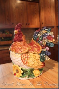 I want this in my kitchen.  My theme is roosters and sunflowers with red pops of color and butter yellow walls.