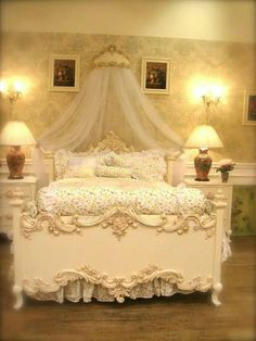 Beautiful bed with lots of french embellishments.  The room is well balanced, not sure I like all the lights in the same area.