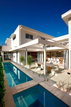 Manly Beach House by Sanctum Design in Manly, Australia. We love the split pool and patio with curtains!