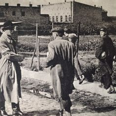 August 1st, 1944, Warsaw. Resistance soldiers of AK (Home Army) heading towards meeting place at Evangelic cemetery.  See the white-red armband with letters WP for Wojsko Polskie (Polish Army)  From Dni Powstania