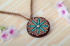 Round pendant with a colorful pattern can transform any outfit and make your look truly unique! Pear wood is used for the manufacture of accessory. The item is cut out manually using the art of contour carving, painted and covered with matt vanish. Accessory is also equipped with an acrylic... see more details at https://bestselleroutlets.com/arts-crafts-sewing/beading-jewelry-making/jewelry-making-kits/product-review-for-handmade-pendant-wooden-pendanr-designer-accessory-unu