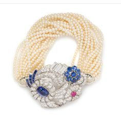 A Convertible Platinum, Gold, Sapphire, Ruby, Diamond and Seed Pearl Brooch/Bracelet, Raymond