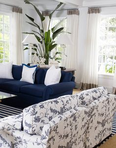 Blue and white living room - add a patterned couch to existing navy one?