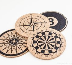 Stenciled Anthro-Inspired Cork Coasters by One Dog Woof | One of a HUGE collection of DIY Drink Coasters over at thinkingcloset.com.  Such great gift ideas!