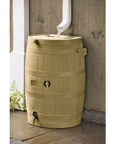 Great flat back rain barrel, 50 gallon, hose attachment lower and spigot mid way up barrel to allow filling of any size watering can.