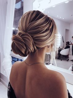 Easy bun, with lots of pieces surrounding the face