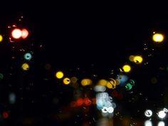 Bokeh lights at night and rain on the window