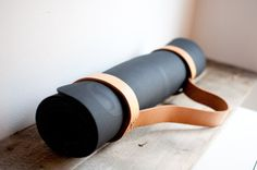 Make all your fellow yogi's jealous with this handmade leather yoga mat sling. Comes with black hardware and black stitching. Pictured with the Lulu