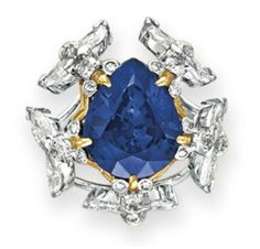 A SAPPHIRE AND DIAMOND RING, BY JEAN SCHLUMBERGER, TIFFANY & CO.   Set with a pear-shaped sapphire, weighing approximately 6.32 carats, within a circular, marquise and single-cut diamond bee surround, mounted in 18k gold and platinum  Signed Schlumberger for Jean Schlumberger, Tiffany & Co.