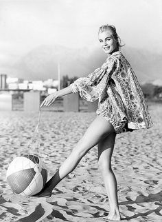 1957 Model in playsuit and beach cover-up