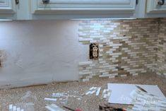 Coastal Inspired DIY Tile Backsplash Tutorial (anyone can do! Diy Tile Backsplash, Vinyl Wood Planks, It's Easy, Coastal, Artsy, Canning, Inspired, Kitchen, Diy Tiles