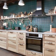 Ikea's  torhamn kitchen, I love the color of the cabinets, light but still interesting for a darker space