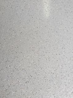 """Dakota on gray is a great combination. Here are samples of the 1/16"""" size flake broadcast in a medium amount on a whisper gray urethane. The flakes are a bit large in the photos but they are small and make a good accent."""
