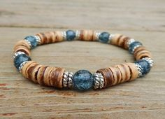 This mens casual bracelet is made with 8mm Coco Wood and Montana Blue Crackle Czech glass.  BlueStoneRiver Home Page