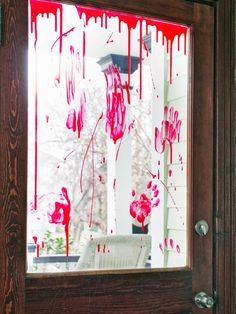 Crime-Scene Front Door or Windows - Spooky Front Porch Decorating Ideas for Halloween on HGTV