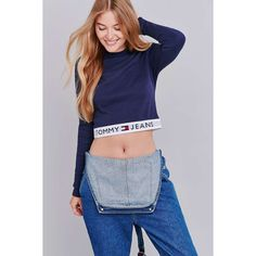 UO Exclusive Tommy Jeans Banded Navy Long Sleeve Cropped Top ($83) ❤ liked on Polyvore featuring tops, tommy hilfiger top, blue crop top, blue top, crew neck crop top and crop top
