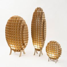 """LAMPYRIDAE LAMPS BY MONICA CORREIA: Firefly-inspired: Lampyridae Lamps by Monica Correia are inspired by """"the form and warm light of fireflies,"""" a series of three, CNC laser cut from plywood with darkened edges left as finish."""