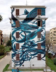 Portuguese street artist Antonio Correia aka Pantonio depicts fluid swarms of fish, birds, and other creatures as they interweave dramatically on the sides of buildings.