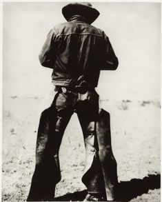 "circa 1934– ""Rear view of a man wearing chaps and spurs""  –Photo McCormic Co., Amarillo, Texas."