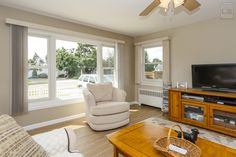 New combination of double hung windows and large picture window in this bright and radiant living room  . . . . . . . . . .  Home Remodeling / Renovations / Home Improvements / Replacement Windows from Renewal by Andersen Long Island Living Room Windows, Living Room Tv, Living Room Remodel, Small Living Rooms, Family Rooms, Double Hung Windows, Front Windows, House Windows, Front Doors