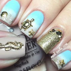 Ocean Inspired Nails With Gold Seashells, Starfish, Seahorse, and a Turtle.