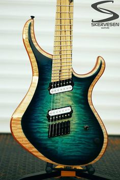 Skervesen Lizard 7. Quilted maple top with burst, high gloss finish. Pale moon ebony fretboard.