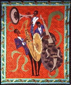 """Carolyn Mazloomi describes herself as """"simply a quilter who happens to be African American."""" Quilt artist, curator, and author of the new book on Afro-American quilting, """"Spirits of the Cloth,"""" Dr. Mazloomi may happen to be African American, but she is far more than """"simply"""" a quilter."""