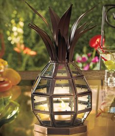 Indoor or outdoor Pineapple Candle Lantern.  1 foot tall and can be used with votive candle or led.