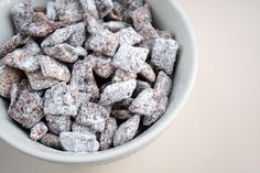 Puppy Chow  1/4 cup butter  (1 stick)  3/4 cup peanut butter  1 bag chocolate chips  1 (12 oz.) box Chex Cereal (corn or rice)  3 cups powdered sugar  1 paper grocery bag or gallon size Ziploc bag