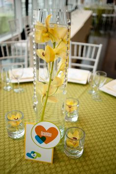 Simple, sweet centerpieces in Friedman Court. Stout Photography.