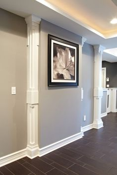 Basement wall idea. For basement wallwith odd bumpout due to utility (heating) units. Great idea to addvertical molding to look like pillars.