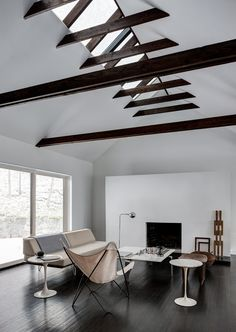 Nice semi-exposed trusses and feature fireplace wall.